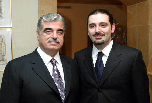 Ex-Lebanese PM Saad al-Hariri, (right) with his father,